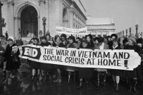 A group of women belonging to the Jeanette Rankin Brigade march in protest of the Vietnam War. Jeanette Rankin, the first female congress member, stands holding the banner at center (wearing eyeglasses). January 15, 1968 Washington, DC, USA